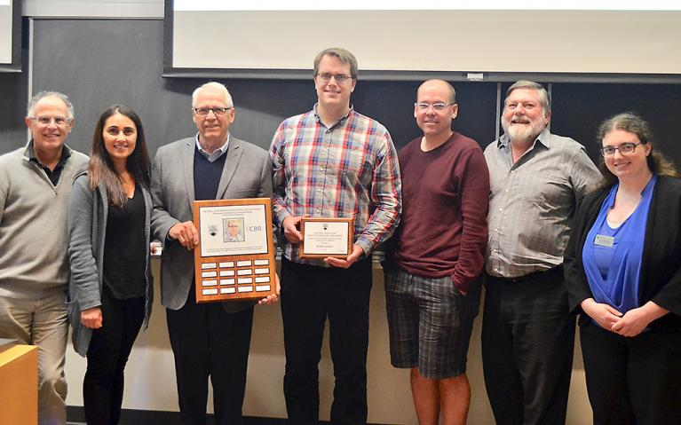 ward presentation ceremony. (Left to right)  Ed Conway (Director, CBR) Solmaz Sobhanifar (2015 winner) Roger Page (Michael's father) Evan Haney (2016 winner) Leonard Foster (Head, Biochemistry & Molecular Biology) Ross MacGillivray (Michael's graduate supervisor) Sarah Henderson (Faculty of Graduate and Postdoctoral Studies)